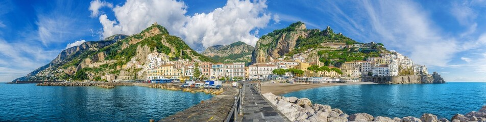 Poster Coast Beautiful panorama of Amalfi, the main town of the coast on which it is located taken from the sea. Amalfi situated in province of Salerno, in the region of Campania, Italy, on the Gulf of Salerno.