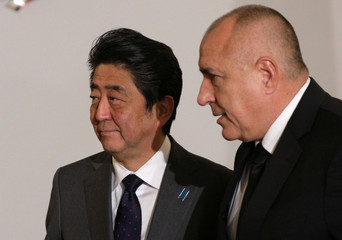 Bulgaria's Prime Minister Borissov walks with Japan's Prime Minister Abe before their meeting in Sofia