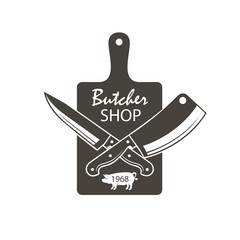 monochrome butcher shop emblem of kithen cutting board, crossed knives and pig