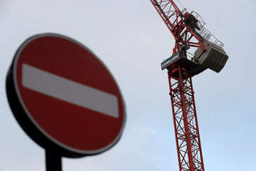 Cranes stand on a Carillion construction site in central London