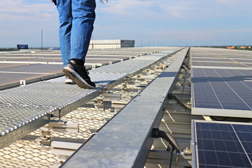 Solar PV Rooftop with Technician Walking on Walkway