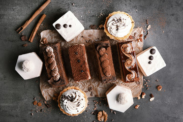 Assortment of tasty pastries on grey background