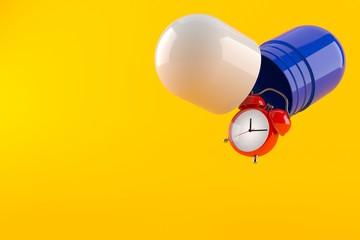 Alarm clock with pill