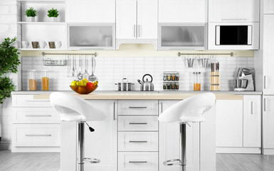 Modern kitchen interior with wooden table and microwave oven