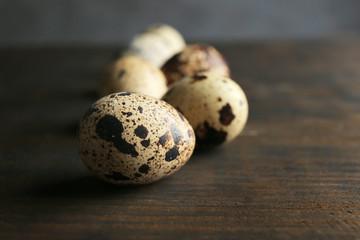 Quail eggs on wooden table