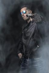 young man holding a pop gun