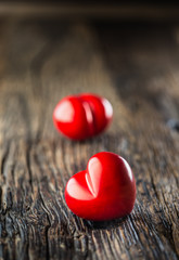 Valentines red heart. One two red heart on wooden table. Wedding or valentine day