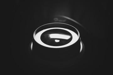Lens. Close-up. Monochrome. Black background.