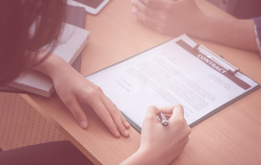 New Employer is signing job contract on interviewing table
