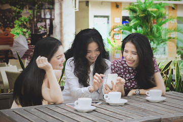 Beautiful woman with phone and her friends