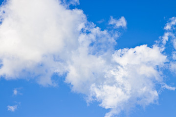 Blue sky background with white clouds - image with copy space