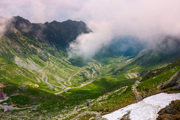 valley of Transfagarasan route in summertime. gorgeous view from the top through the clouds