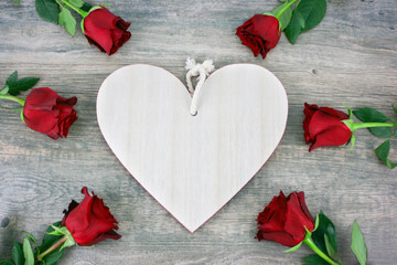 Rustic Wooden Heart and Red Roses Over Wooden Background for Valentine's Day Holiday with Copy Space, Horizontal
