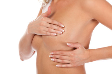 Woman holding her breast, breast cancer concept, isolated on white background