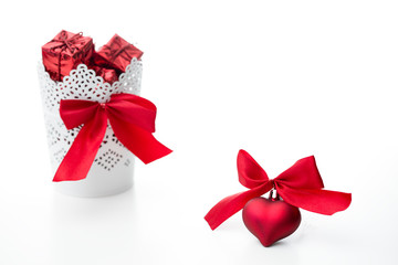 gift and heart with a bow of red color on a white background