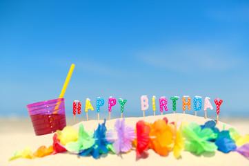 Happy birthday candles at beach