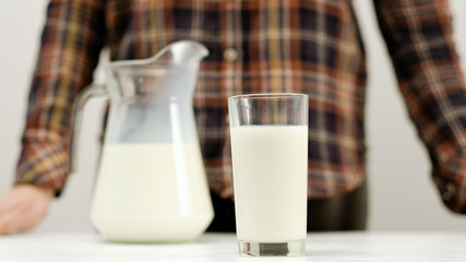 Glass full of milk on white background. Organic dairy. Natural healthy drink. Calcium and vitamin D