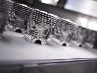 Detail of aluminum castings in a motorcycle engine production line.
