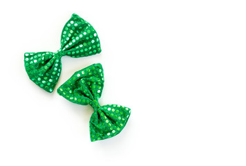2 bright green bow ties with sequins for St. Patrick's Day isolated on white