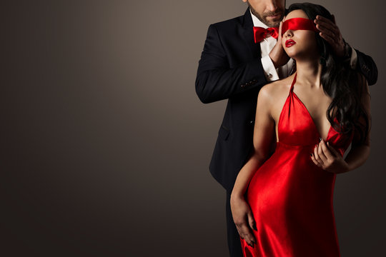 Couple Love Kiss, Sexy Blindfolded Woman Dancing in Red Dress and Elegant Man in Suit