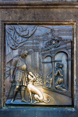 An old relief below the statue of St. John of Nepomuk on Charles Bridge in Prague, Czech Republic.