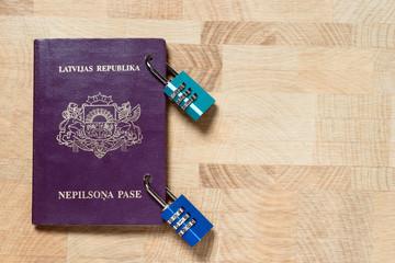Latvian alians purple passport locked with combination locks, concept