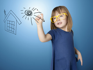 Cute little girl paints on glass houseand sun