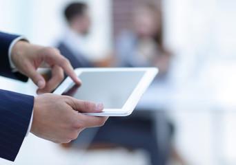 closeup.businessman with tablet computer