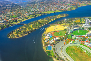 Aerial view of Perth and Swan River in Australia. Scenic flight over Heirisson Island, New Perth Stadium, Cricket Pitch, WACA Ground in Western Australia.