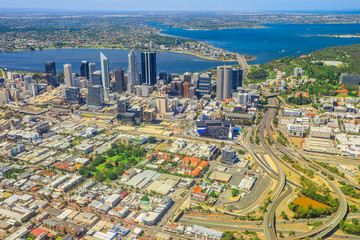 Aerial view of Perth Downtown and Skyline in Australia. Scenic flight over Bell Tower, Narrows Bridge, Swan River, Kings Park, Mill Point, Perth Convention and Exhibition Center in Western Australia.
