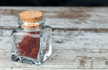 saffron threads in a glass jar