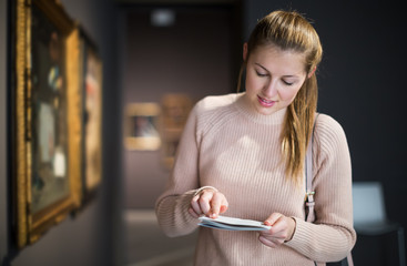 Woman at exhibition in museum