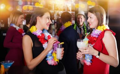 Two women on Hawaiian party at nightclub