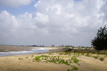 View of the coast in Kenya with clouds and blue sky.