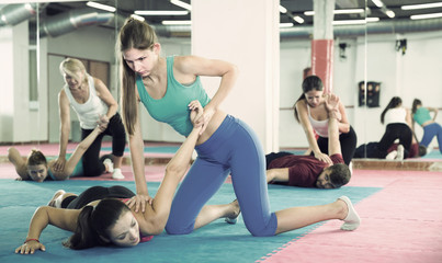 Women are training self-defence moves in pairs