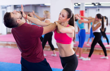 Sports female are training self-defence moves