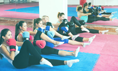 Group of women are doing training sitting