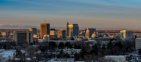 Early morning sunlight on the Boise skyline in winter with snow