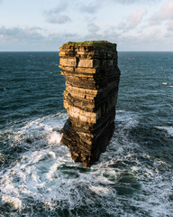 Downpatrick Head sea stack standing in the atlantic ocean in Ireland during sunset