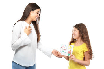 Cute little girl giving greeting card to her mom on white background. Mother's day celebration