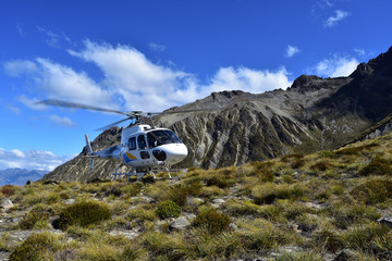 A helicopter on the slopes of a mountain