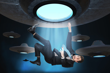 Poster UFO Alien abduction concept. Young man is abducted by UFO.