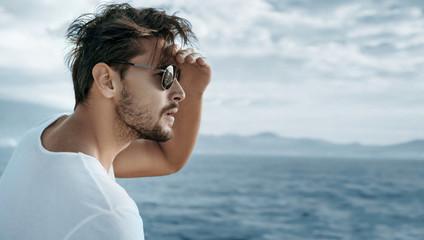 Printed kitchen splashbacks Artist KB Portrait of a handsome man watching ocean waves