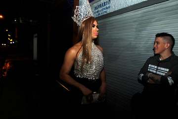 """A participant stands outside the venue before the beauty contest """"Mrs Colombia"""" in Medellin"""