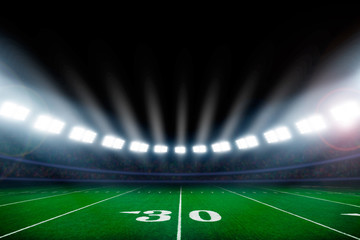 American football field illuminated by stadium lights