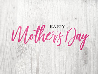 Happy Mother's Day Pink Calligraphy Text Over Rustic Whitewashed Wood Texture