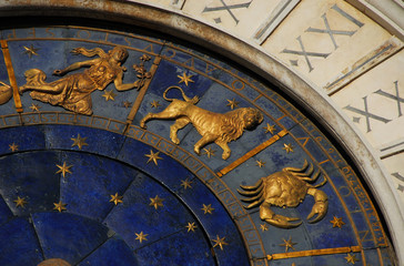 Ancient time, Horoscope and Astrology. Detail of Saint Mark Square renaissance Clock Tower in Venice with zodiac signs Leo, Cancer, Virgo, planet and stars (15th century)
