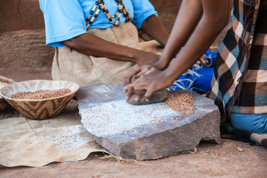 African woman grinding
