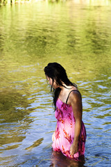 Young Japanese American Woman Standing In River Wet