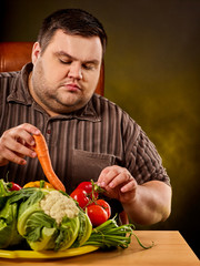 Diet fat man eating healthy food. Healthy breakfast with vegetables cauliflower. Male trying to lose weight. Overweight person was on diet for long time. Products with zero calorie content.